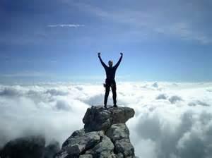 person climbing mountain_550x412
